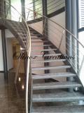Escalier limon cintré en métal peint