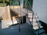 Escalier structure inox avec palier marches en Pierre